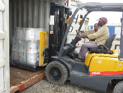 Local workers unload shipment of materials sent from the UK.