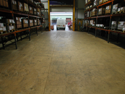 Warehouse Before Self Smoothin Resin Flooring Treatment