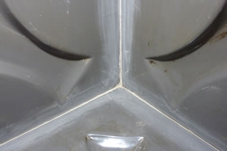 Specialist Coatings (GB) Ltd: Leaking fibreglass water tank joint repair service.
