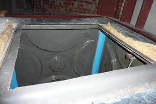 Specialist Coatings (GB) Ltd: Leaking fibreglass water tank joint repair service